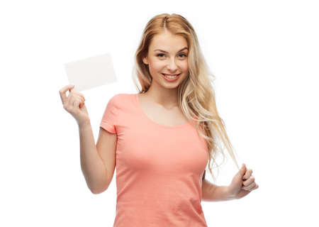 white paper: advertisement, invitation, message and people concept - smiling young woman or teenage girl with blank white paper card