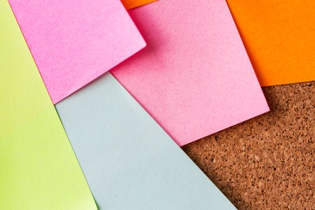 paper board: business, information, memo, management and education concept - close up of blank paper stickers on cork board Stock Photo