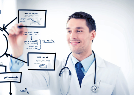 a medical technology: healthcare, medical and technology concept - young doctor working with something imaginary