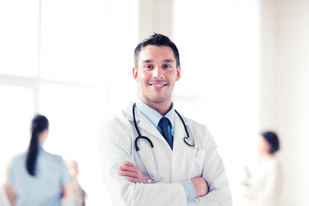 healthcare and medical concept - young male doctor with stethoscope Stock Photo