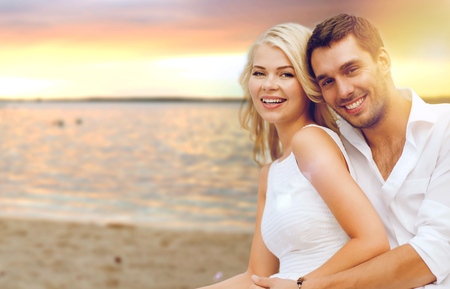 couple dating: summer holiday, vacation, dating and tourism concept - happy couple having fun on the beach Stock Photo