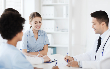 profession: hospital, profession, people and medicine concept - group of happy doctors meeting at medical office Stock Photo