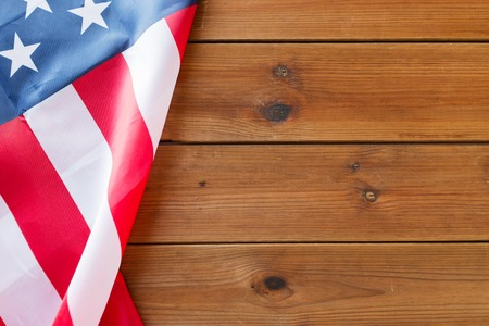 american independence day, patriotism and nationalism concept - close up of american flag on wooden boards Foto de archivo