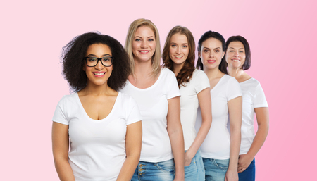 diverse: friendship, diverse, body positive and people concept - group of happy different size women in white t-shirts over pink background