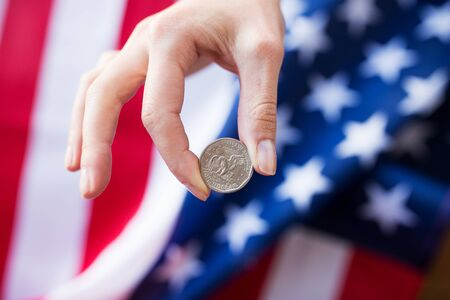 money crisis: finances, money, crisis, investment and national currency concept - ose up of hands with coins over american flag