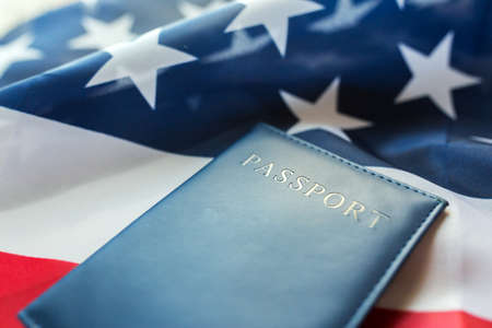 nationalism: citizenship, patriotism and nationalism concept - close up of american flag and passport