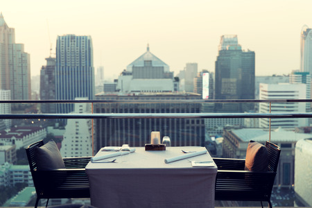city building: travel, vacation, tourism and business concept - roof top restaurant lounge at hotel in bangkok city