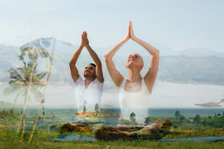 yoga retreat, fitness, sport and lifestyle concept - smiling couple making exercises sitting on mats outdoors, double exposure effect Stock Photo