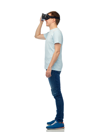 3d technology, virtual reality, entertainment, cyberspace and people concept - happy young man with virtual reality headset or 3d glasses Stock Photo