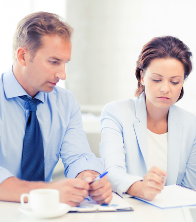 common goal: picture of business team discussing something in office