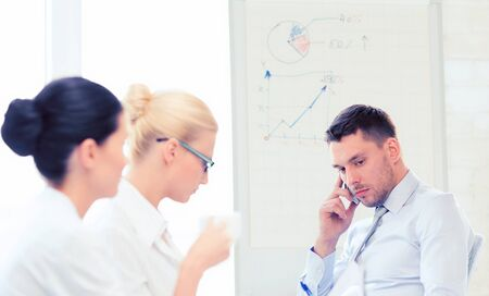 regress: stressed male boss on business meeting with team in office Stock Photo