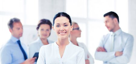 executive woman: picture of smiling attractive businesswoman in office Stock Photo