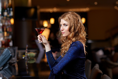 woman bar: people, party, nightlife, drink and holidays concept - glamorous woman with cocktail at night club or bar
