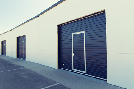warehouse building: storage, building structure and architecture concept - garage or warehouse exterior Stock Photo