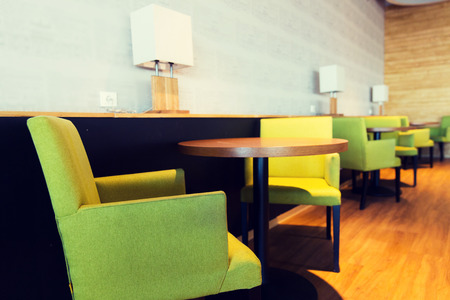 restaurant tables: design, public place, furniture and interior concept - close up of restaurant interior with tables and chairs