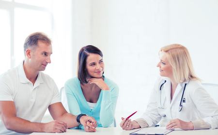 disease patients: healthcare and medical concept - doctor with patients in cabinet