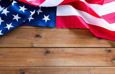 american independence day, patriotism, national and memorial concept - close up of american flag on wooden boards with copy space