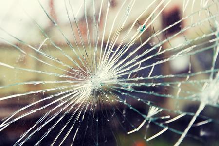 vandalism: damage, violence, vandalism and danger concept - broken glass with cracks