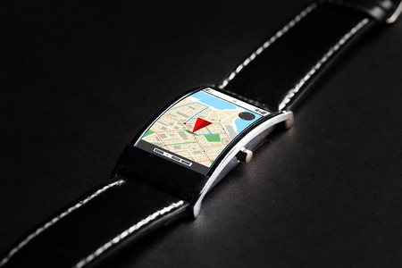 gprs: modern technology, navigation, location, object and media concept - close up of black smart watch with gps navigator map on screen Stock Photo