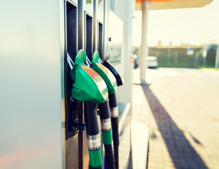fueling pump: object, fuel, oil, tank and transport concept - close up of gasoline hose at gas station Stock Photo