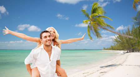 thailand beach: travel, tourism, summer holidays, vacation and love concept - happy couple having fun over exotic tropical beach with palm trees background