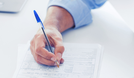 school form: business, office, school and education concept - man filling tax form