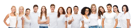 diverse, gesture and people concept - group of happy different body size and age and gender people in white t-shirts hugging showing thumbs up Foto de archivo