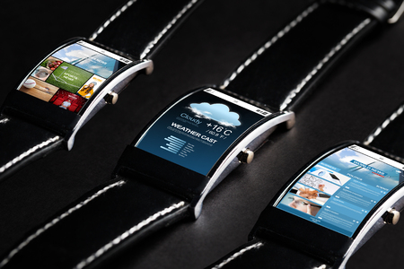 news cast: modern technology, object and media concept - close up of black smart watch set with weather cast and business news application Stock Photo