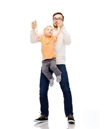 kiddy: family, childhood, fatherhood, leisure and people concept - happy father and little son playing and having fun Stock Photo