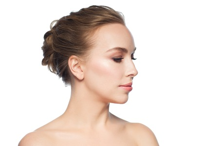 profile face: health, people, plastic surgery and beauty concept - beautiful young woman face over white background