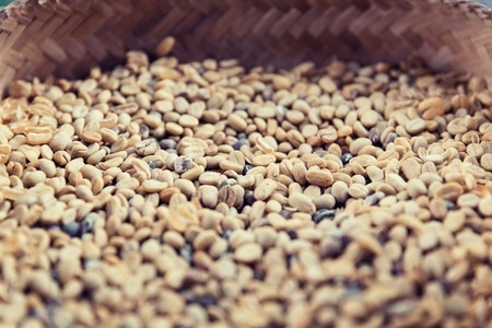 unroasted: sale, harvest, agriculture and food concept - close up of unroasted coffee beans in basket