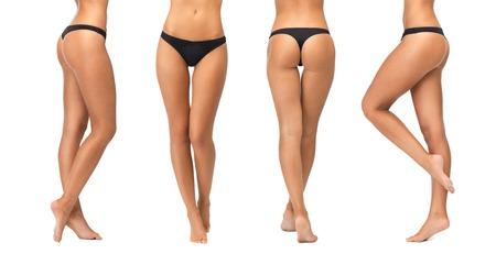 人、美容、ボディケア、下着、痩身コンセプト - 女性の脚と白い背景に黒いビキニパンツの底
