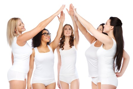 gesture, friendship, beauty, body positive and people concept - group of happy different women in white underwear making high five
