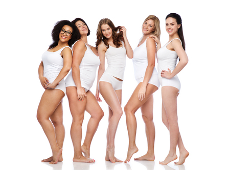 friendship, beauty, body positive and people concept - group of happy women different in white underwear