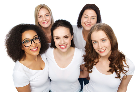 middle age women: friendship, diverse, body positive and people concept - group of happy different size women in white t-shirts