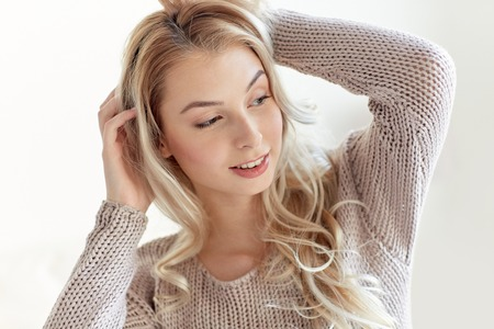 blonde teenager: people concept - happy young woman or teenage girl at home