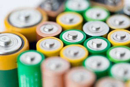 alkaline: recycling, energy, power, environment and ecology concept - close up of alkaline batteries heap