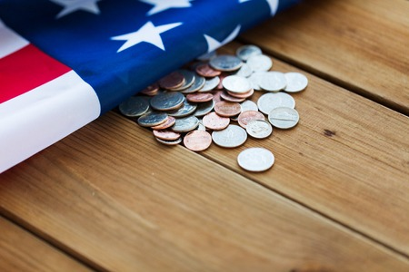 budget crisis: budget, finance, money, crisis and nationalism concept - close up of american flag and cent coins