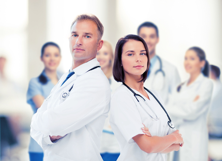 physicians: healthcare and medical concept - two doctors with stethoscopes