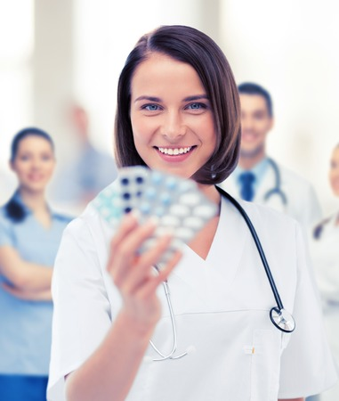 healthcare and medical concept - doctor with blister packs of pills Stock Photo