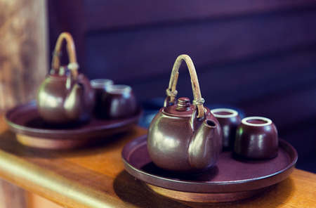 teahouse: drinks, pottery and asian tradition concept - tea-set at asian teahouse