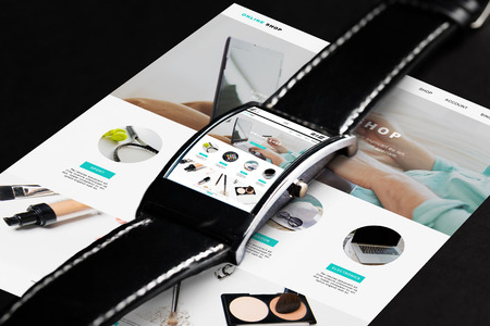 web screen: modern technology, internet shopping, object and media concept - close up of black smart watch with online shop web page on screen Stock Photo