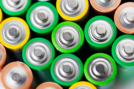 power concept: recycling, energy, power, environment and ecology concept - close up of alkaline batteries heap