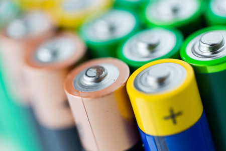 heap up: recycling, energy, power, environment and ecology concept - close up of alkaline batteries heap