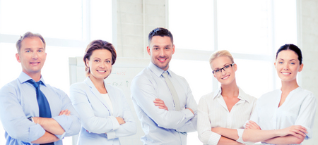business team: picture of friendly business team in office Stock Photo