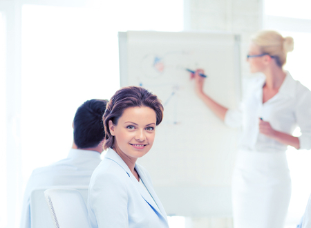 business management: picture of smiling businesswoman on business meeting in office Stock Photo