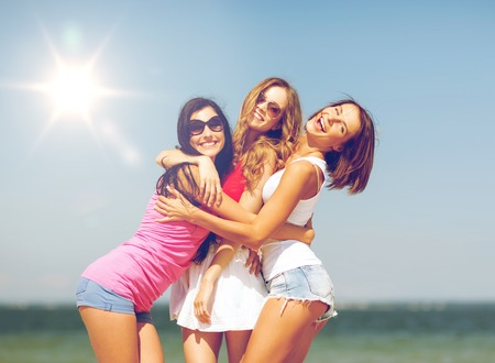 summer holidays and vacation - group of girls having fun on the beach