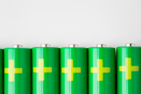 commercial recycling: recycling, energy, power, environment and ecology concept - close up of green alkaline batteries Stock Photo