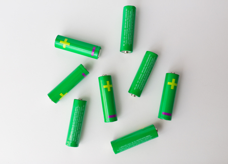 ecological environment: recycling, energy, power, environment and ecology concept - close up of green alkaline batteries Stock Photo