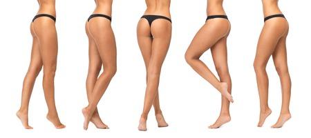 gente, belleza, cuidado del cuerpo, la ropa interior y el concepto de adelgazamiento - piernas femeninas y abajo en bragas negras sobre fondo blanco